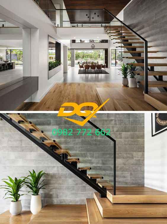 Nếu không muốn sử dụng gầm cầu thang làm kệ tivi, bạn có thể áp dụng một cách trang trí phòng khách có cầu thang khác đó là làm bể thủy sinh hay làm tiểu cảnh